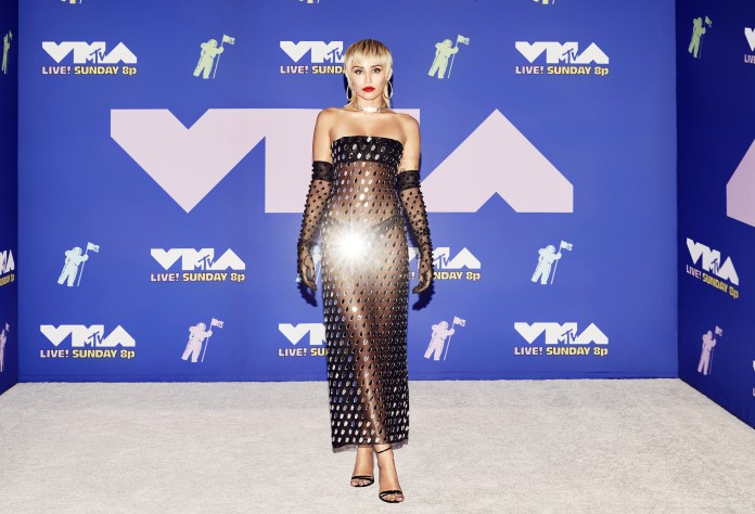 She coordinated the ensemble with transparent black elbow-length gloves