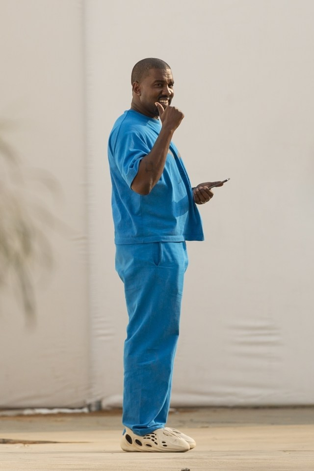 The Yeezy designer flashed a big smile as he spoke on the phone at the LA campus