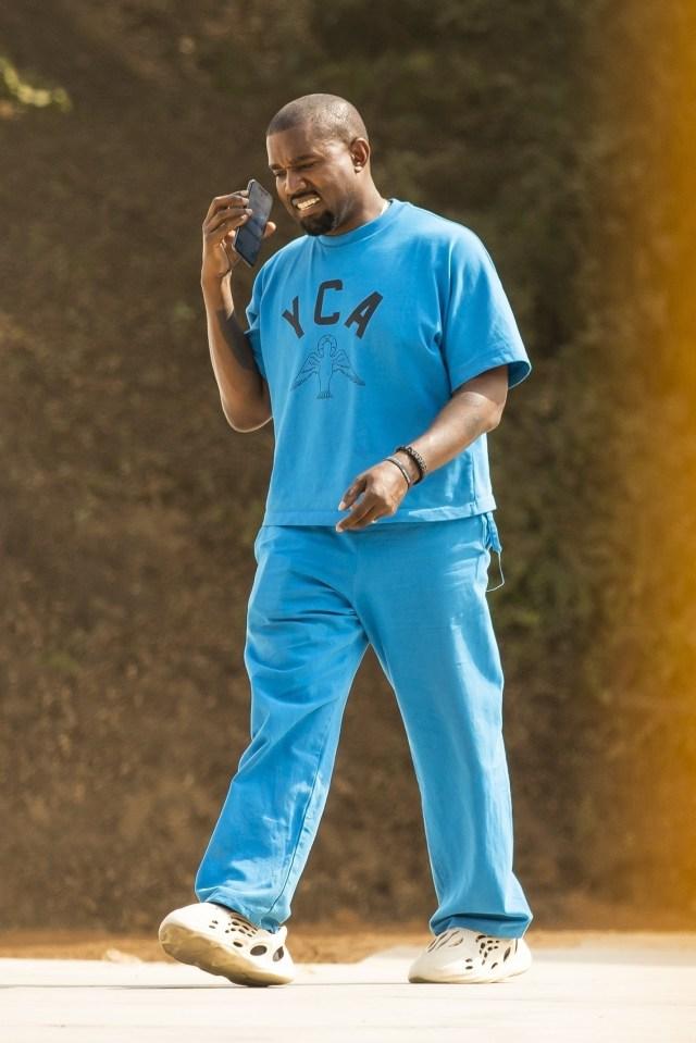 The music mogul wore a matching bright blue YCA uniform on Wednesday