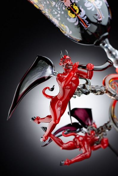 The book features glass devils, some in sexually explicit positions