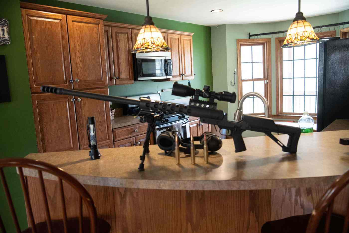 A 50-caliber gun sits on a counter top inside the Fortitude Ranch