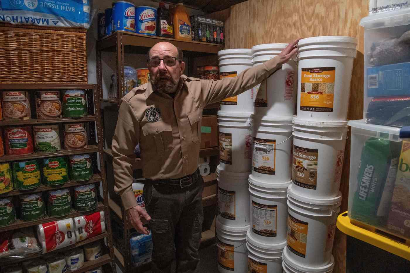 Fortitude Ranch Chief Operating Officer Steve Rene speaks inside a storage room stacked with food in Mathias, West Virginia