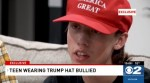 High school boy, 15, seen in cellphone video being called a 'racist' and spat on 'because of his Trump hat'