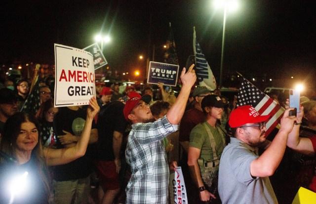 Trump's loyal followers carried signs like 'keep America great'