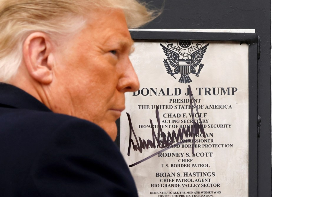 Trump signed a plaque at the wall