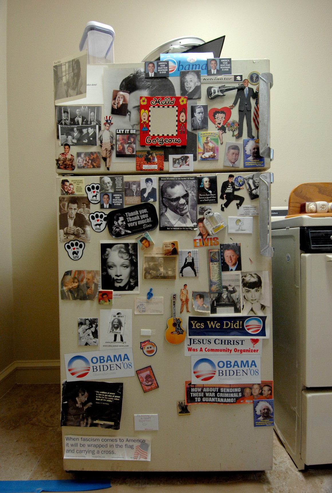 The music mogul's fridge, covered in magnet decorations