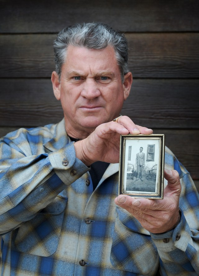 Peter holds a picture of his beloved dad Vincent Zazzara