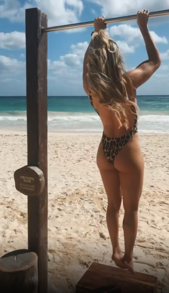 The AEW star showing how to do pull-ups ion the sand