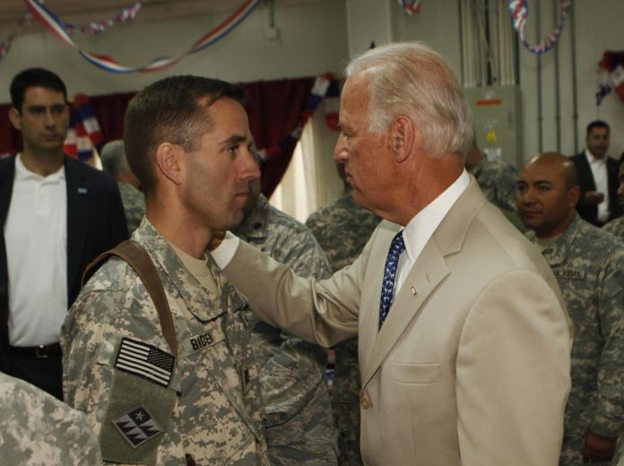 Joe Biden talks with Beau Biden at Camp Victory on the outskirts of Baghdad on July 4, 2009