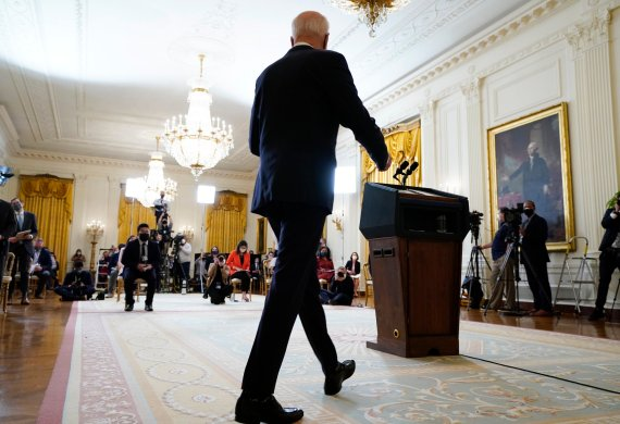 President Joe Biden arrives to speak during a news conference in the East Room of the White House