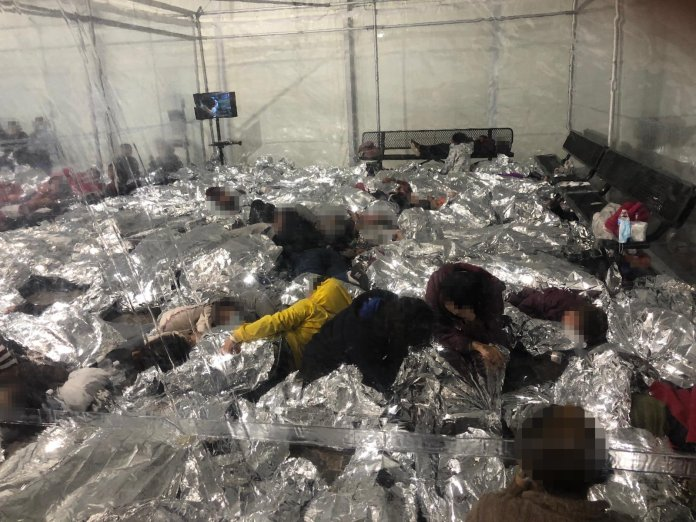 images from inside the sheltershowing hellish crowded conditions with children packed in side by side