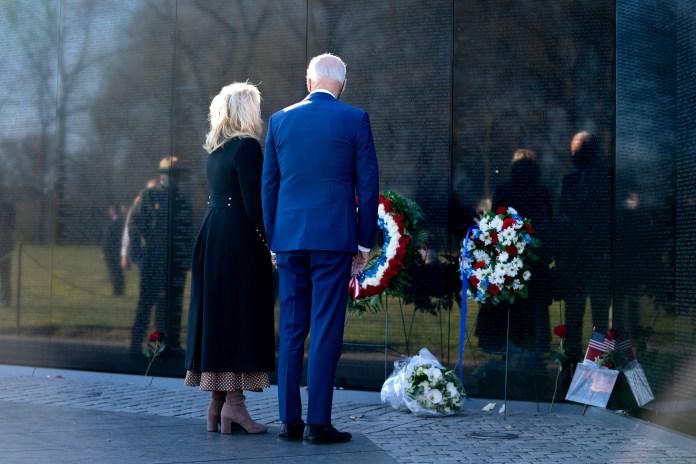 President Joe Biden and First Lady Dr. Jill Biden, center, visit the Vietnam War Memorial in Washington, D.C