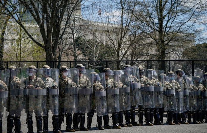 US National Guard troops patrol streets surrounding the Capitol