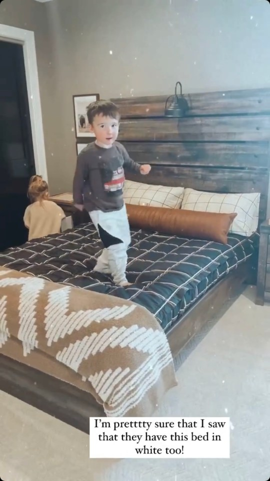 The four-year-old has a dark wood bed and furniture