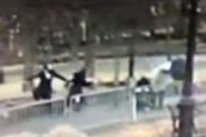 The footage shows the man slashing the baby through the stroller