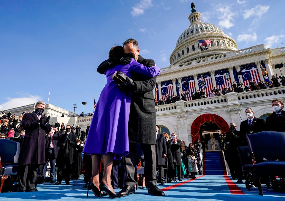 Doug Emhoff has been labelled the 'perfect man' after blowing kisses at wife Kamala Harris