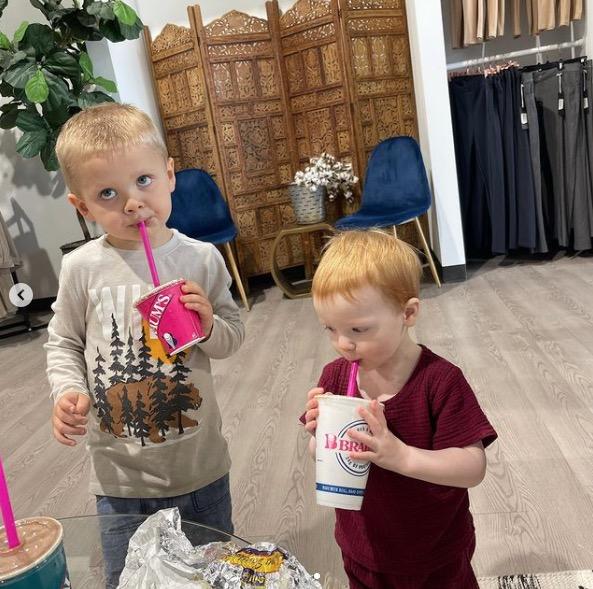 Their sons enjoyed some milkshake as their moms caught up