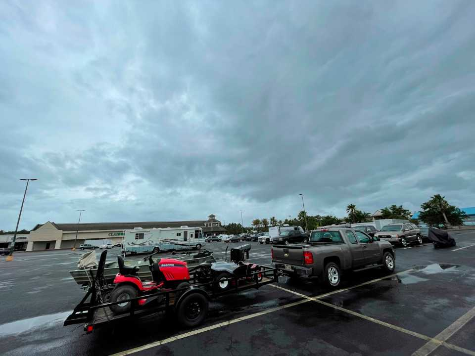 Mississippi residents in low-lying areas were moving move their vehicles, lawn mowers, ATVs and boats to higher ground on Friday