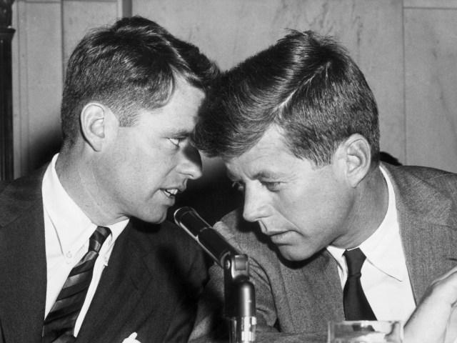 Robert Kennedy (left) huddles with his brother, Senator John F. Kennedy