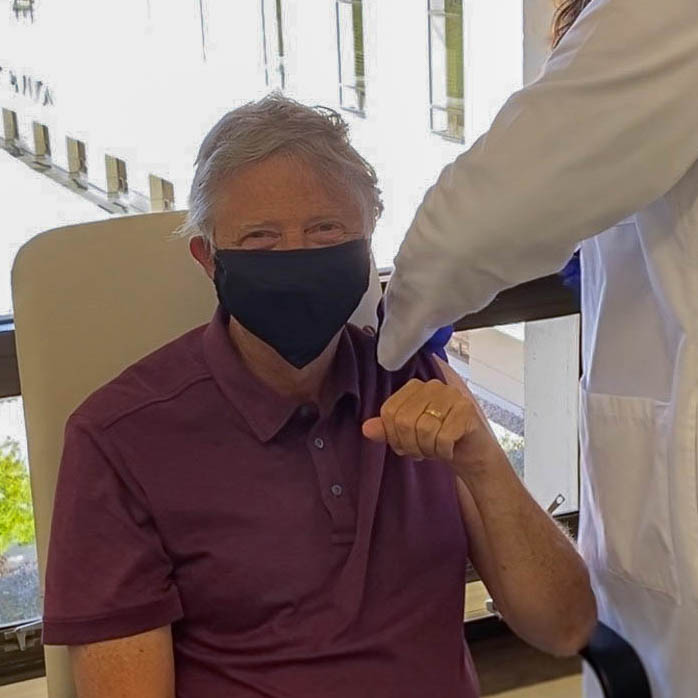 Bill Gates tweeted a photo of himself receiving his first dose of the Covid vaccine in January 2021