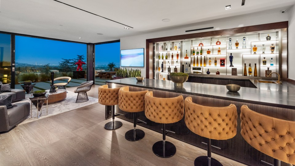 The property boasts chic modern furniture and impressive views