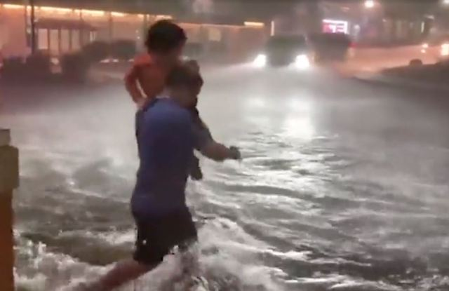 Desperate commuters ran through the rising water