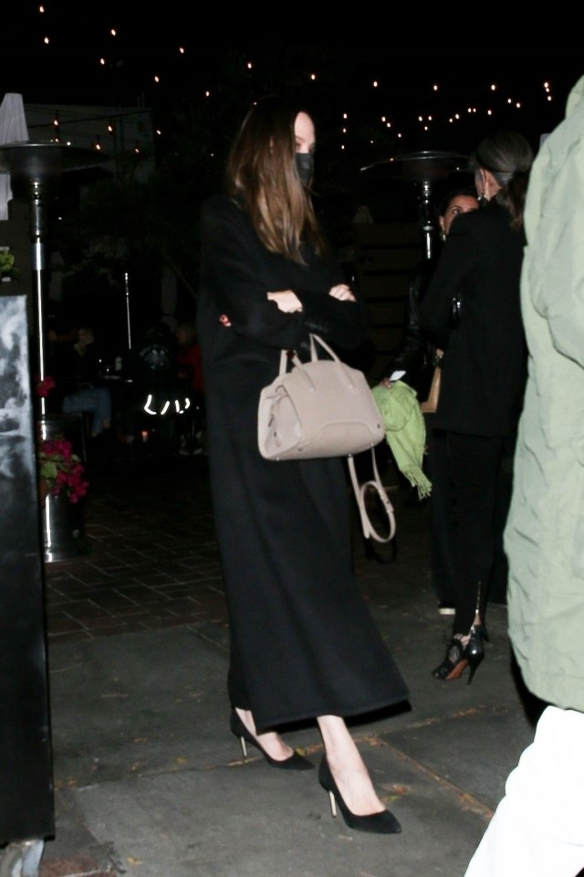 Angelina, 46, who is in the midst of a messy divorce from ex-husband Brad Pitt, was seen in a long black coat and suede heels