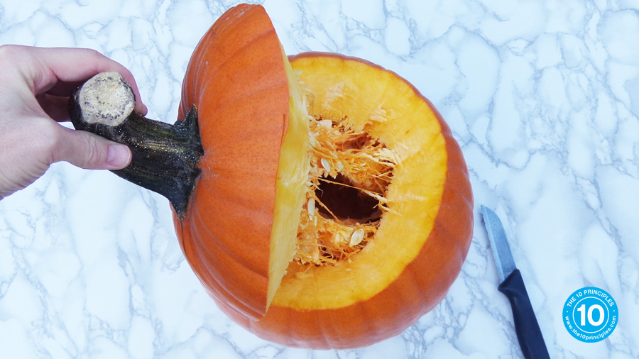 De-cap your pumpkin and scoop out the seeds