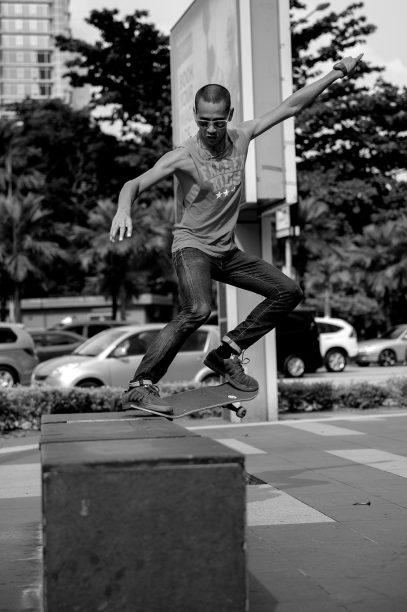 skateboarder jumping rail kuala lumpur malaysia
