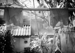 luang prabang monk robes washing line