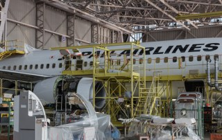 An aircraft in pieces in a factory