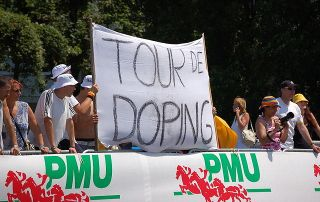 Anti-doping protesters with a protest banner