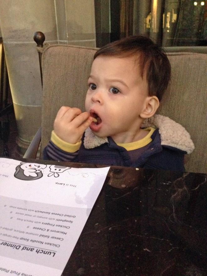 Tucker eating fries