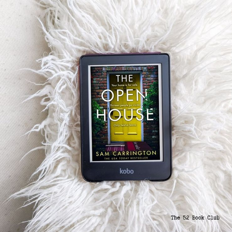 The Open House book cover on e-reader lying on a white fluffy pillow and background.