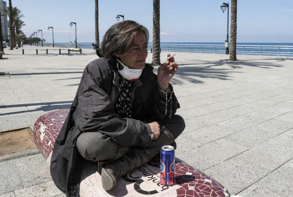 A lady smokes on Beirut corniche amid coronavirus pandemic