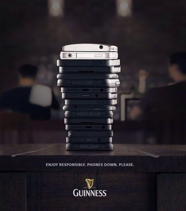Guinness ad showing phones stacked to look like a cup of beer.
