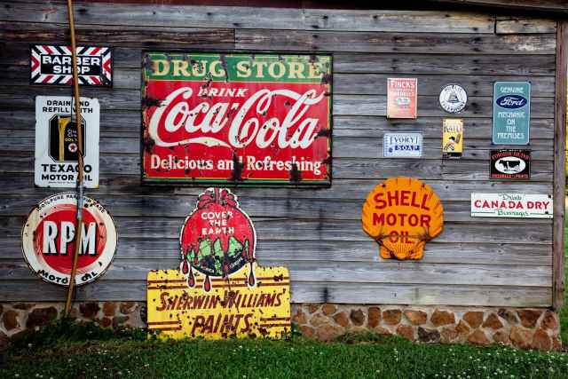drug store drink coca cola signage on gray wooden wall will different types of advertising