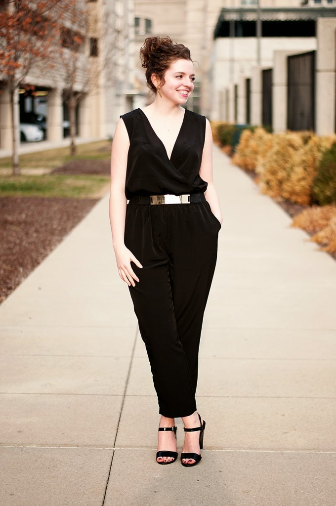 Black jumpsuit with gold belt