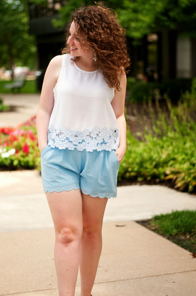 White crop top with blue scalloped shorts