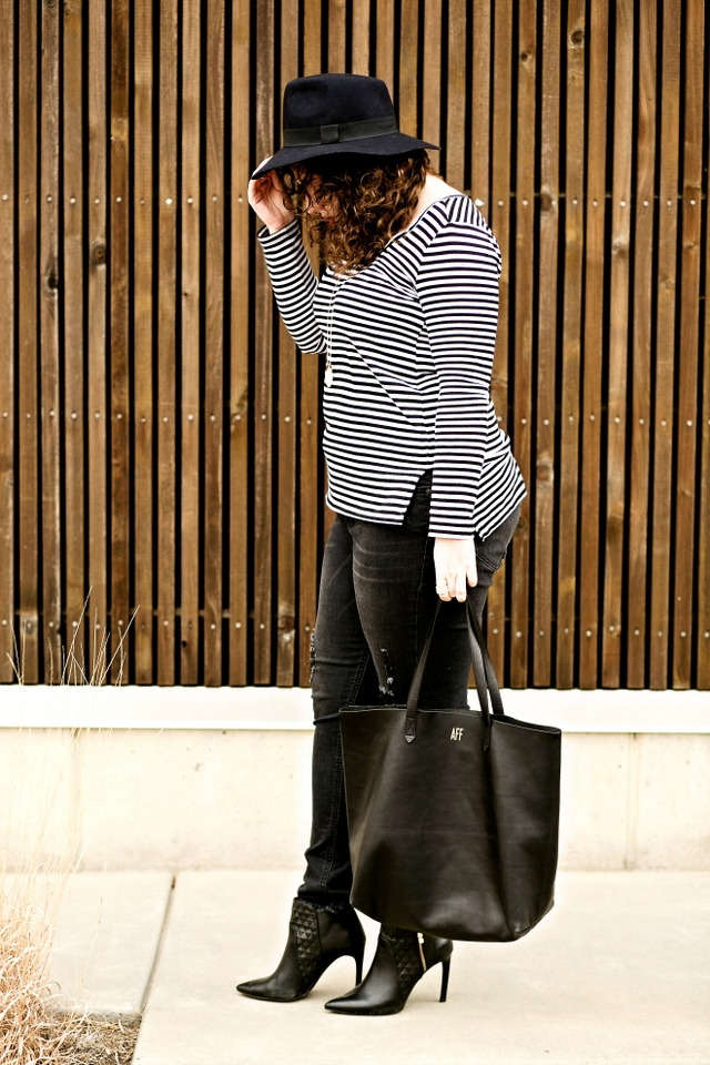 Black and white outfit with destructed denim and booties | theadoredlife.com