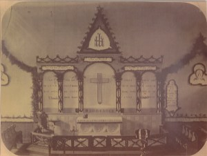 The cross which so angered Bishop Eastburn is pictured here above the altar in the church's third building, on Green Street in the old West End of Boston. Both cross and altar are now located in the present All Saints Chapel. (from the collection of Donovan R. Bowley, PhD)
