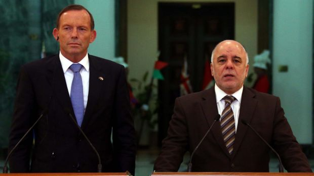 Iraqi Prime Minister Haider al-Abadi and Australia's Prime Minister Tony Abbott address the media in Baghdad.