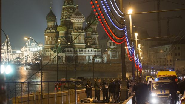 Russian police investigate the the body of Boris Nemtsov, a former Russian deputy prime minister and opposition leader at Red Square with St. Basil Cathidral in the background in Moscow, Russia.