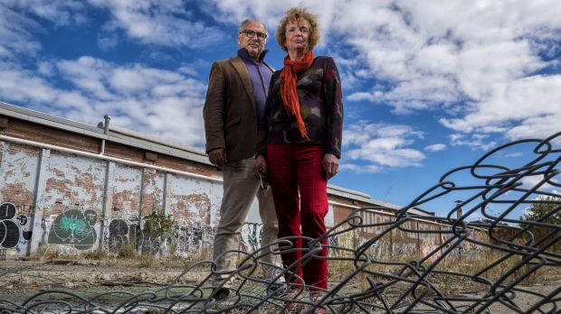 Helen Halliday and former Port Phillip councillor David Brand, from the Fishermans Bend Network group, outside contaminated land in South Melbourne. They want better planning for the new area.