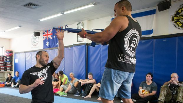 Ex-Israeli infantry soldier and police detective Lior Offenbach runs a demonstration on disarming an attacker after a Krav Maga class at IDF Training in Caulfield.