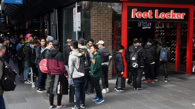People line up for limited edition runners at the opening of Foot Locker in Bourke St Mall.