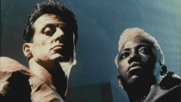 "Sylvester Stallone with Wesley Snipes in ""Demolition Man"": He has sued the film studio over revenue from the film."