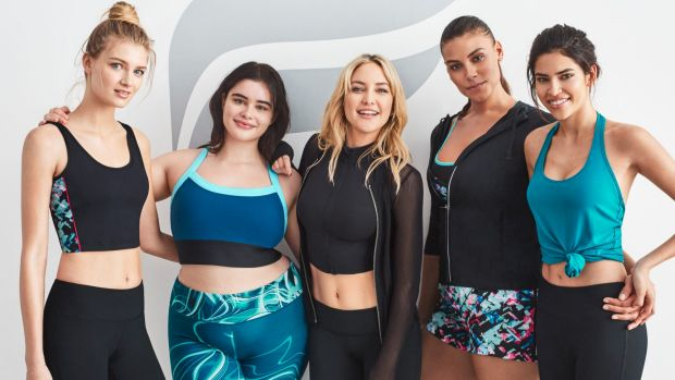 Kate Hudson (centre) with models in her Fabletics active wear, which has recently expanded its size range.