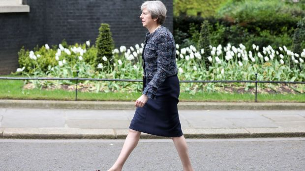 Theresa May, U.K. prime minister, arrives in 10 Downing Street after meeting Queen Elizabeth II to mark the dissolution ...