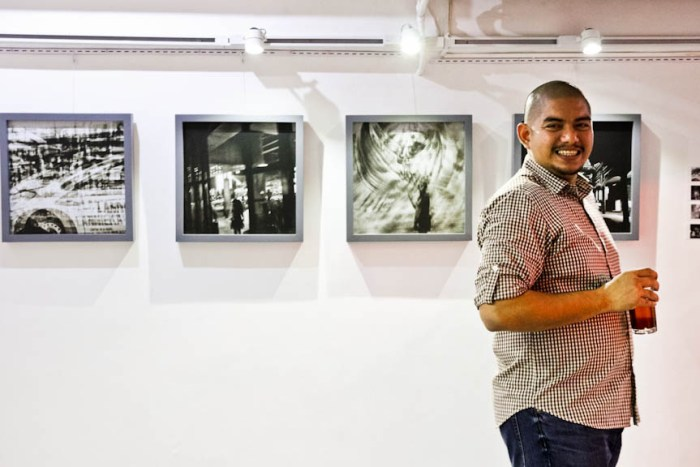 """Photojournalist Veejay Villafranca at the opening of his """"IRONIC"""" photo exhibit at the Pineapple Lab in Poblacion, Makati City. Photo by: Chris Quintana"""